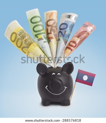 Ten,twenty,fifty,one hundred and a 200 Euro banknote in a smiling piggybank of Laos.(series) - stock photo