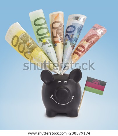 Ten,twenty,fifty,one hundred and a 200 Euro banknote in a smiling piggybank of Malawi.(series) - stock photo
