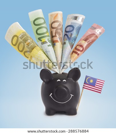 Ten,twenty,fifty,one hundred and a 200 Euro banknote in a smiling piggybank of Malaysia.(series) - stock photo