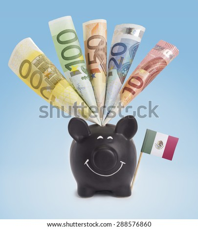 Ten,twenty,fifty,one hundred and a 200 Euro banknote in a smiling piggybank of Mexico.(series) - stock photo