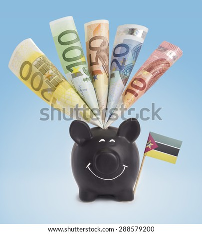 Ten,twenty,fifty,one hundred and a 200 Euro banknote in a smiling piggybank of Mozambique.(series) - stock photo