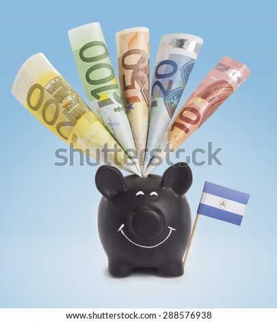 Ten,twenty,fifty,one hundred and a 200 Euro banknote in a smiling piggybank of Nicaragua.(series) - stock photo