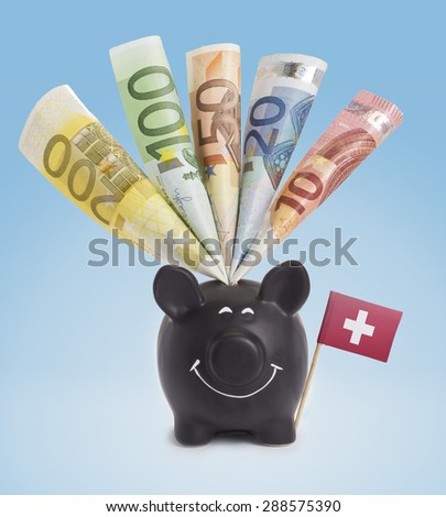 Ten,twenty,fifty,one hundred and a 200 Euro banknote in a smiling piggybank of Switzerland.(series) - stock photo