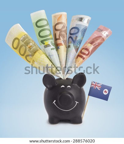 Ten,twenty,fifty,one hundred and a 200 Euro banknote in a smiling piggybank of Tasmania.(series) - stock photo