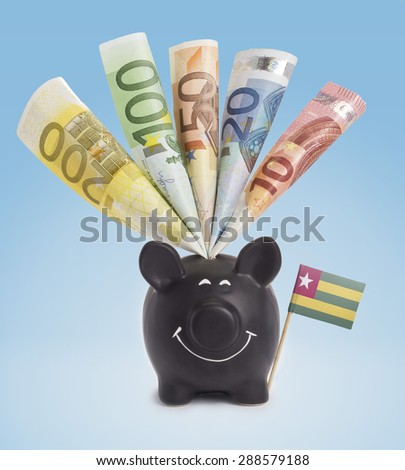 Ten,twenty,fifty,one hundred and a 200 Euro banknote in a smiling piggybank of Togo.(series) - stock photo