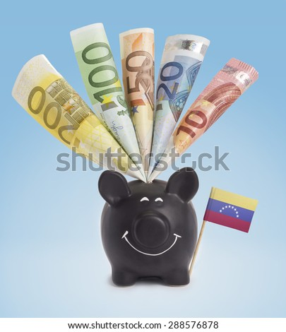 Ten,twenty,fifty,one hundred and a 200 Euro banknote in a smiling piggybank of Venezuela.(series) - stock photo