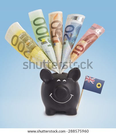 Ten,twenty,fifty,one hundred and a 200 Euro banknote in a smiling piggybank of Western Australia.(series) - stock photo