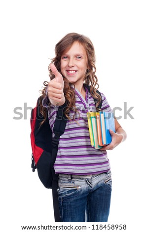 ten year girl holding books and showing thumbs up. isolated on white background - stock photo