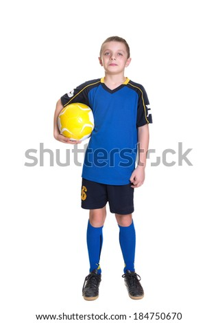 Ten year old boy with a soccer ball isolated on white background. - stock photo