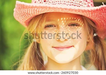 Ten year old caucasian girl outdoors wearing summer hat. - stock photo
