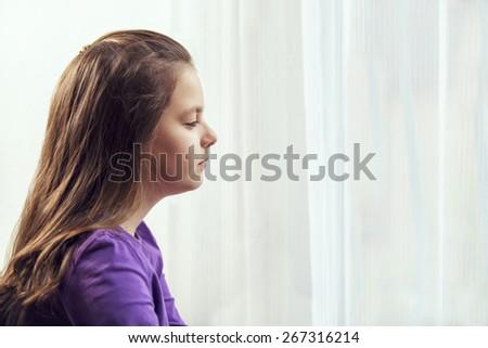 Ten year old caucasian girl with long hair posing - stock photo
