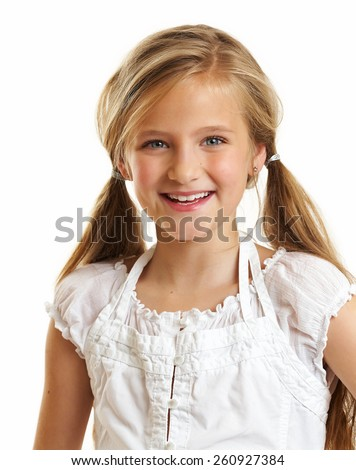 Ten year old caucasian girl with long hair posing isolated on white. - stock photo