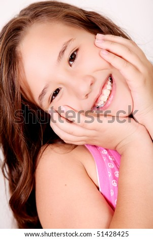 Ten years old girl smiling and looking at camera