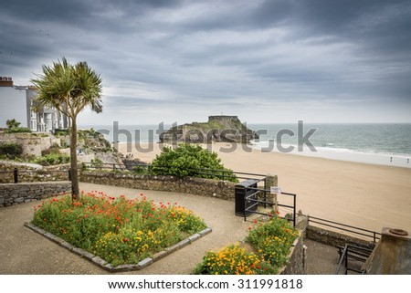 Tenby, Wales. A view across to St Catherine's Island with gardens in the foreground - stock photo