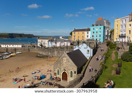 TENBY, WALES-AUGUST 18th 2015: Beautiful summer sunshine and warm weather drew visitors and tourists to the seaside at Tenby, Wales on Tuesday 18th August 2015