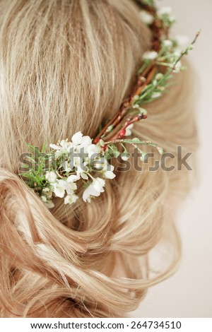 Tender beauty bride's hair with flowers wreath on it - stock photo