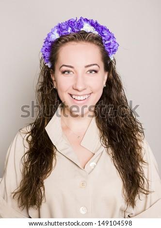 Tender beauty portrait, floral wreath in hair - stock photo