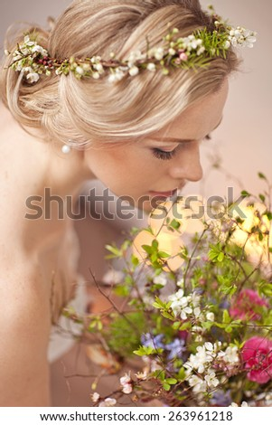 Tender beauty portrait of bride with flowers wreath in hair - stock photo