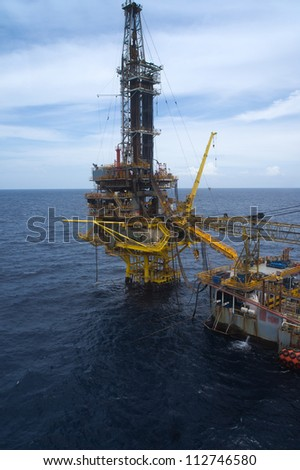 Tender Drilling Oil Rig (Barge Oil Rig) on The Production Platform - stock photo