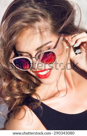 Tender fashion portrait of beautiful gentle young brunette woman with silk bow on the neck cosmetics for body face hair pure natural beauty, organic and diet harmony, makeup,bright trendy sunglasses - stock photo