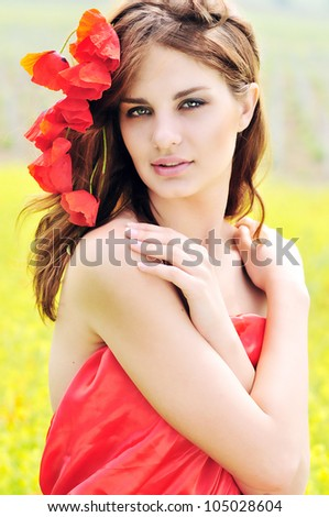 tender girl with poppies in her hair - stock photo