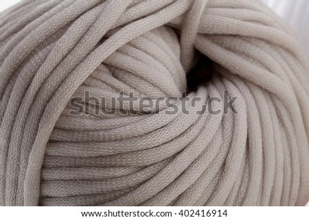 Tender grey wool yarn wrapped in ball. Closeup photo. - stock photo
