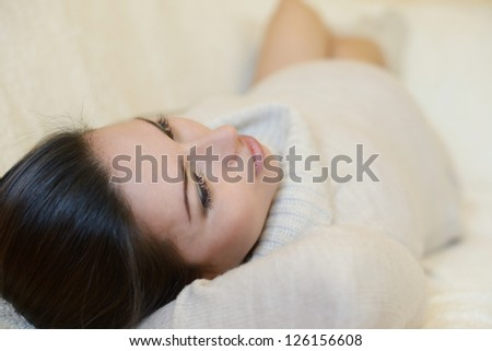 tender pregnant woman lying on the sofa - stock photo