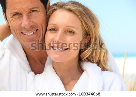 tender senior couple near the sea - stock photo