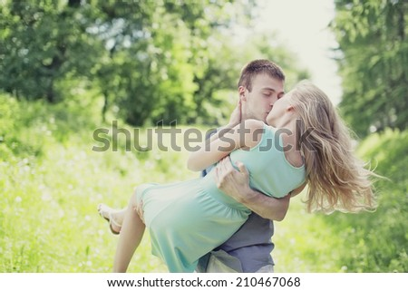 Tender sweet kiss couple outdoors, love, relationships - concept - stock photo