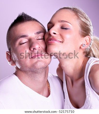 Tender young couple posing, studio shot