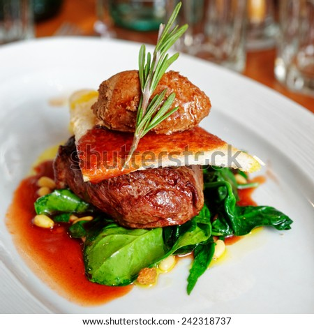 Tenderloin steak with beef terrine and spinach in plate