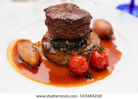 Tenderloin steak with vegetables, close-up - stock photo