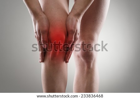 Tendon problems on woman's leg indicated with red spot. Joint inflammation concept. - stock photo