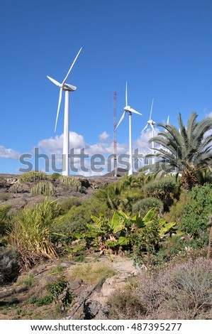 TENERIFE, CANARY ISLANDS - JANUARY 25, 2012: A group of modern windmills wind power , are among the vegetation south of the island