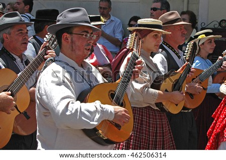 TENERIFE, CANARY ISLANDS - JUNE 21, 2009: Group with guitars and lutes , walking the streets of La Orotava Pilgrimage