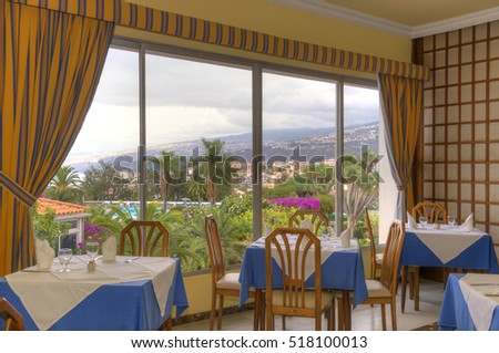 TENERIFE, CANARY ISLANDS - SEPTEMBER 12, 2013: Dining room overlooking gardens, in a hotel in the tourist city of Puerto de la Cruz