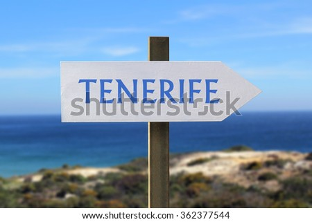 Tenerife sign with seashore in the background
