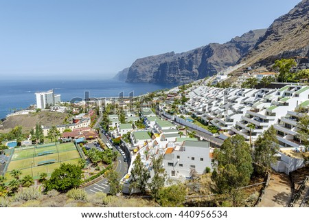 Tenerife, Spain - August 14, 2015: Los Gigantes, Tenerife, Canary Islands, Spain, famous for its giant cliffs of the ridge of the Teno massif which is 6 miles long and is a small holiday resort town - stock photo