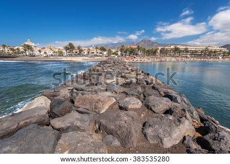 TENERIFE, SPAIN - FEBRUARY 23. Tourist in Las Americas beach on February 23, 2016 in Adeje, Tenerife, Spain.  Las Americas is one of the most popular and touristic resorts, in Tenerife South area.