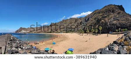 TENERIFE, SPAIN - JULY 13: Panoramic view of famous beach Playa de las Teresitas on july 13, 2014 inTenerife, Spain - stock photo