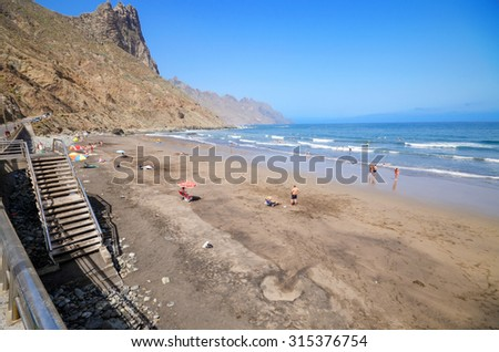 TENERIFE, SPAIN - JULY 7: Some tourist are relaxing in Taganana beach, on July 7, 2015 in North Tenerife, Canary islands, Spain.
