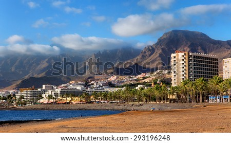 TENERIFE, SPAIN - JULY 17: View of the Playa de las Americas. Playa de las Americas is a purpose-built holiday resort in the southern and southern-west part of the Municipality of Arona - stock photo