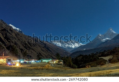 Tengboche monastery in the Moonlight. Mount Everest on the background - Nepal, Himalayas - stock photo