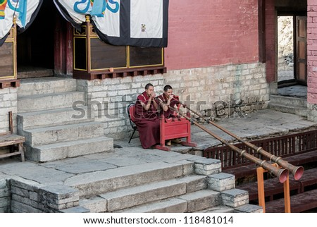 TENGBOCHE, NEPAL - OCTOBER 29: The monks accompany dances of trumpets. Festival of Tengboche Monastery Practice and Masked Mani Rimdu Dances to the Khumbu region on October 29, 2012 in Tengboche - stock photo