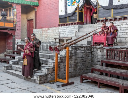 TENGBOCHE, NEPAL - OCTOBER 29: The monks are awaiting their dance. Festival of Tengboche Monastery Practice and Masked Mani Rimdu Dances to the Khumbu region on October 29, 2012 in Tengboche - stock photo