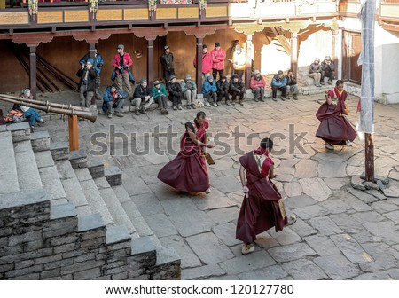 TENGBOCHE, NEPAL - OCTOBER 29: The monks perform group ritual dance. Festival of Tengboche Monastery Practice and Masked Mani Rimdu Dances to the Khumbu region on October 29, 2012 in Tengboche, Nepal - stock photo