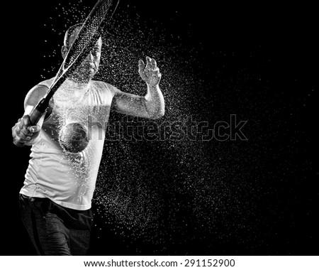Tennis action shot. Backhand. Studio shot over black. - stock photo