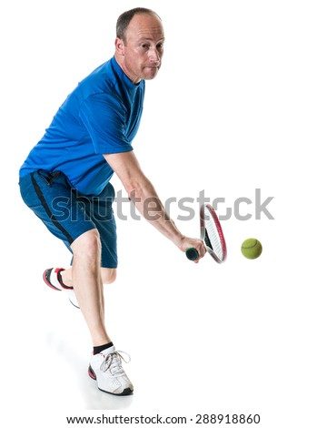 Tennis action shot. Backhand. Studio shot over white. - stock photo
