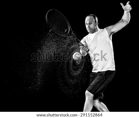Tennis action shot. Forehand. Studio shot over black. - stock photo
