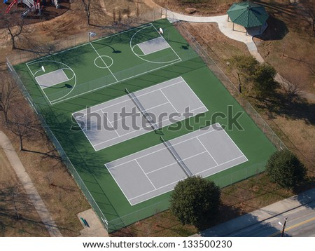 Tennis and basketball courts aerial in a eastern US public park. - stock photo